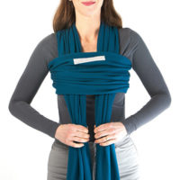Bring the slack through the horizontal layer, which we will now call the 3rd layer. Once the tension is adjusted, the 3rd layer should sit just below your armpits and close to your body.