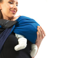 Make sure there is always some fabric between you and your baby's crotch, and that the baby's sitting on it. With one hand, lift your baby up slightly and, with the other hand, spread the lower part of the wrap under his bottom and behind his knees, in order to create a seat for him.
