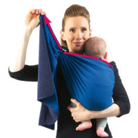 Lift your baby up with one hand and, with the other one, adjust the wrap: grab the inner hem of the tail NEAR THE RINGS, pull it up...